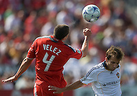 06 June 2009: Los Angeles Galaxy midfielder Mike Magee #18 and Toronto FC defender Marco Velez # 4 in MLS action at BMO Field Toronto in a game between LA Galaxy and Toronto FC. .The Galaxy  won 2-1.