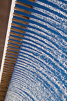 Precision waterfall at Parque das Nações, Lisbon, Portugal. This manmade waterfall, composed of many tubes flowing water at the same pressure, creates a wonderful effect..Parque das Nações, the development originated after the Expo 98, has many examples of modern architecture, both in commercial and residential spaces. This area also features Europe's largest Oceanarium, restaurants, bars, event halls and permanent exhibit halls.  .Parque das Nações is located right next to the Tagus River (Rio Tejo) on the East of Lisbon.