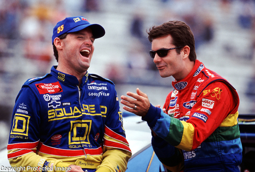 Kenny Wallace and Jeff Gordon share a laugh during qualifying for the Checker Auto Parts/DuraLube 500 at Phoenix International Raceway in November 2000.(Photo by Brian Cleary)