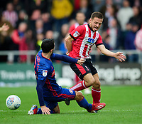 Lincoln City's Jack Payne is fouled by Sunderland's Conor McLaughlin<br /> <br /> Photographer Andrew Vaughan/CameraSport<br /> <br /> The EFL Sky Bet League One - Lincoln City v Sunderland - Saturday 5th October 2019 - Sincil Bank - Lincoln<br /> <br /> World Copyright © 2019 CameraSport. All rights reserved. 43 Linden Ave. Countesthorpe. Leicester. England. LE8 5PG - Tel: +44 (0) 116 277 4147 - admin@camerasport.com - www.camerasport.com