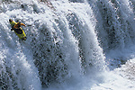 A whitewater kayaker paddles a waterfall in northwest Wyoming.