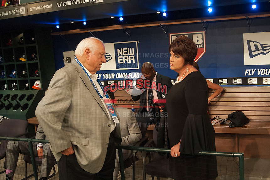 Pitcher Grant Holmes (Conway H.S. (SC)) the number 22 overall pick to the Los Angeles Dodgers mom speaks with Hall of Famer Tommy Lasorda during the MLB Draft on Thursday June 05,2014 at Studio 42 in Secaucus, NJ.   (Tomasso DeRosa/ Four Seam Images)