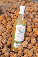 On a street market. Le bourru, half fermented grape juice. Walnuts. Bordeaux city, Aquitaine, Gironde, France