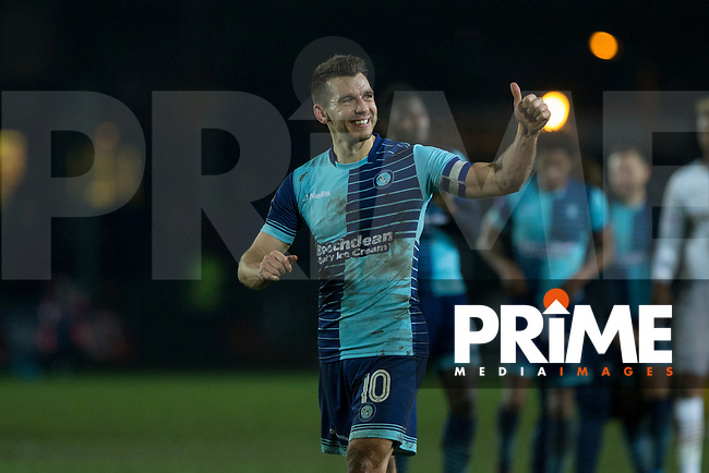 Matt Bloomfield of Wycombe gives a thumbs up to the fans at full time of the Sky Bet League 2 match between Newport County and Wycombe Wanderers at Rodney Parade, Newport, Wales on 22 November 2016. Photo by Mark  Hawkins.