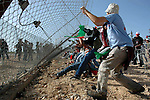 Palestinian demonstrators demolish the wall  during a demonstration on the sixth anniversary of the construction of the wall in Bil'in village  in the West Bank city of Ramallah November 19, 2010. Photo by Nedal Shtieh