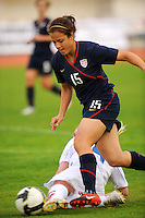 USA's Casey Noguiera attempts to elude a tackle from an Iceland defender.  The USWNT defeated Iceland (2-0) at Vila Real Sto. Antonio in their opener of the 2010 Algarve Cup on February 24, 2010.