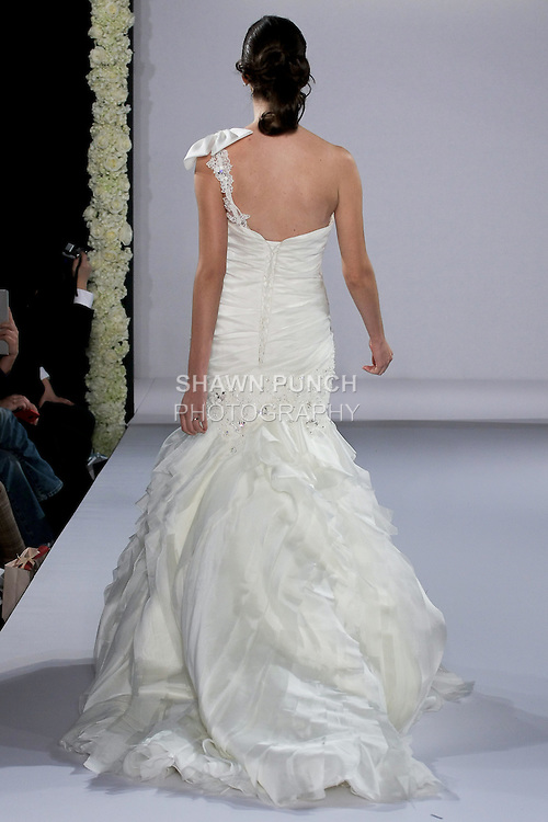 Model walks runway in an Ashlyn Rose wedding dress from the Maggie Sottero Spring 2013 Bridal collection, for the Couture Runway Show, during New York Bridal Fashion Week at The Hilton Hotel, October 13, 2012.