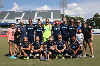 Cary, North Carolina  - Saturday August 19, 2017: North Carolina Courage starters with fans. Front row (from left): Abby Dahlkemper, Kristen Hamilton, fan, McCall Zerboni, Denise O'Sullivan, Taylor Smith, fan; Back row (from left): fan, fan, fan, Abby Erceg, Abby Dahlkemper, Katelyn Rowland, Lynn Williams, Samantha Mewis, Ashley Hatch, fan, and fan prior to a regular season National Women's Soccer League (NWSL) match between the North Carolina Courage and the Washington Spirit at Sahlen's Stadium at WakeMed Soccer Park. North Carolina won the game 2-0.