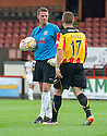Ayr keeper David Hutton isn't too happy with Partick's John Baird after his high and late challenge.