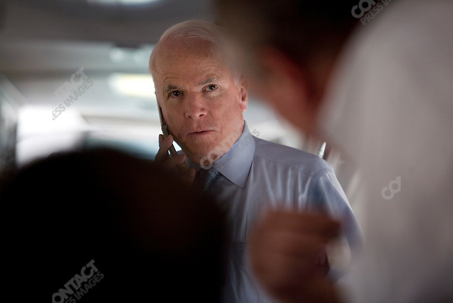 Senator John McCain (R-AZ), Republican presidential candidate, aboard his campaign plane during a fueling stop. Dallas, Texas, January 30, 2008.