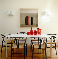 The artwork behind the dining table is a 1950s Danish steinless-steel silk-screen print whilst the chairs are by Finnish designer Ilmari Tapiovaara