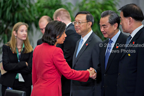 Susan Rice, United States national security advisor, left, greets Wang Yi, China's foreign minister, as she arrives to a P5+1 multilateral meeting at the Nuclear Security Summit in Washington, D.C., U.S., on Friday, April 1, 2016. After a spate of terrorist attacks from Europe to Africa, Obama is rallying international support during the summit for an effort to keep Islamic State and similar groups from obtaining nuclear material and other weapons of mass destruction. <br /> Credit: Andrew Harrer / Pool via CNP