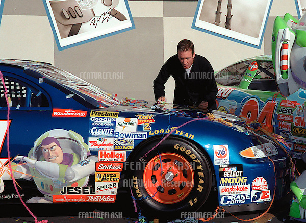 "23OCT99: Actor TIM ALLEN at promotion in Hollywood to unveil three NASCAR racing cars themed to ""Toy Story 2"".  Allen portrays the voice of ""Buzz Lightyear"" in the movie.                          .© Paul Smith / Featureflash"