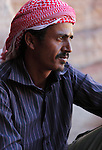 Portrait of Neil, a young Bedouin who guides tourists through the archaeological site of Petra in Jordan. Petra is the most visited tourist attraction in Jordan, a symbol of the country for its historical and archaeological importance. It has been a UNESCO World Heritage Site since 1985. The Bedouin families that have been living for centuries in the caves of Petra, agreed to move out into a small village, built near the site of Petra. Most of them earn their living from tourism which seems to be the only option available, especially for the younger generations.