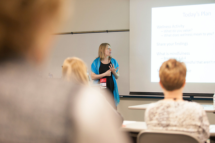 "Katy Kropf, assistant clinical professor of family medicine at the Ohio University Heritage College of Osteopathic Medicine, gives a lecture titled ""Mindfulness: The Art of Being Present"" at the 10th Annual Celebrate Women Conference at Ohio University Lancaster Campus on Friday, March 18, 2016. Photo by Kaitlin Owens"