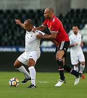 Roberto Martinez of Swansea Legends (L) in challenged by a Manchester United player during the Swansea Legends v Manchester United Legends at The Liberty Stadium, Swansea, Wales, UK. Wednesday 09 August 2017