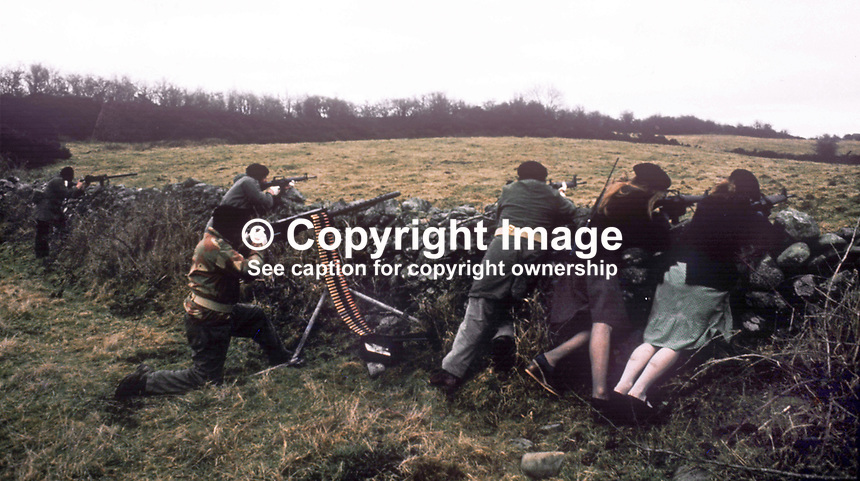 This republican movement press release photograph claims to be of a Provisional IRA border unit on manoeuvres in Co Fermanagh, N Ireland, February 1977.  The men and women volunteers are seen using a variety of weapons i.e. a 50 mm Browning M2 machine gun, a 30 mm machine gun and other automatic weapons. 197702130024c<br />