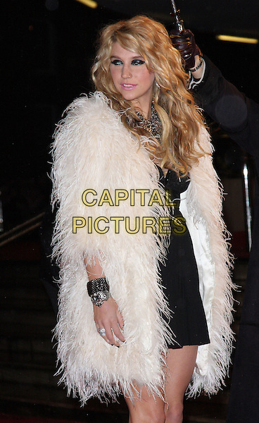 KE$HA aka KESHA (Kesha Rose Sebert).At the Brit Awards 2010 held at Earls Court, London, England, UK,.February 16th 2010.Brits arrivals  half length black white fur coat dress bracelets side .CAP/ROS.©Steve Ross/Capital Pictures.