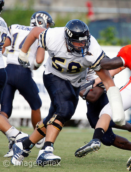15 September 2007: Florida International University offensive lineman Andy Leavine (58) blocks against the University of Miami in Miami's 23-9 victory at the Orange Bowl Stadium, Miami, Florida..
