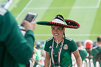 MOSCOW, RUSSIA - June 17, 2018:  A Mexico fan has their photo take before the Germany vs. Mexico 2018 FIFA World Cup group stage match at Luzhniki Stadium.