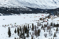 Teams are parked to rest in the sun in the afternoon at the Rainy Pass checkpoint at Puntilla Lake in the Alaska Range during the 2019 Iditarod on Monday, March 4th 2019. Many planes bringing tourist are here at The Perrins Rainy Pass Lodge<br /> <br /> Photo by Jeff Schultz/  (C) 2019  ALL RIGHTS RESERVED