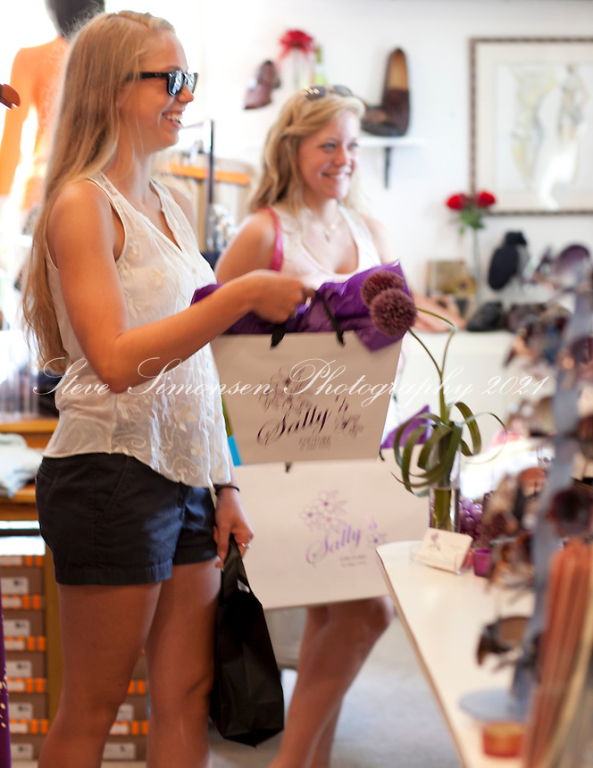 Girls shopping at Sally's Boutique<br />