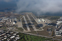aerial photograph of Moffett Field airport, Mountain View, California as a layer of fog burns off
