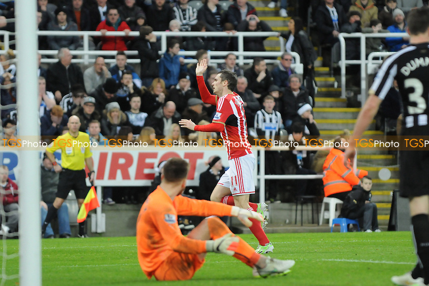 Adam Johnson of Sunderland celebrates scoring the opening goal of the game - Newcastle United vs Sunderland AFC - Barclays Premier League Football at St James Park, Newcastle upon Tyne - 21/12/14 - MANDATORY CREDIT: Steven White/TGSPHOTO - Self billing applies where appropriate - contact@tgsphoto.co.uk - NO UNPAID USE