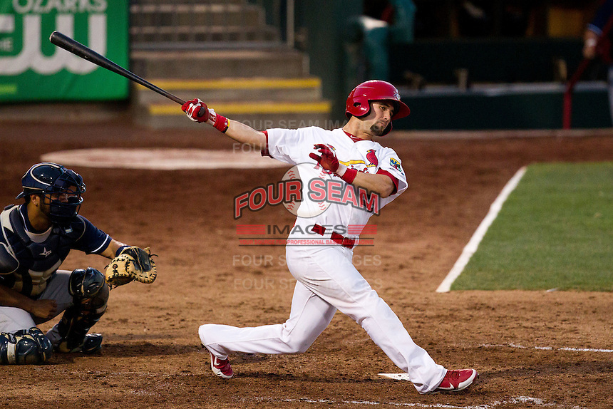 Adam Melker (26) of the Springfield Cardinals swings at a pitch during a game against the Arkansas Travelers at Hammons Field on July 24, 2012 in Springfield, Missouri. (David Welker/Four Seam Images)