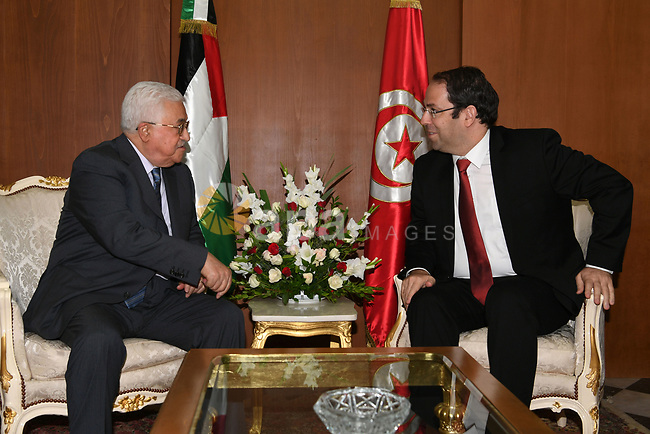 Palestinian President Mahmoud Abbas meets with Tunisian prime minister Youssef Chahed in Tunis, on July 7, 2017. Abbas is on 2 day official visit to Tunisia. Photo by Thaer Ganaim