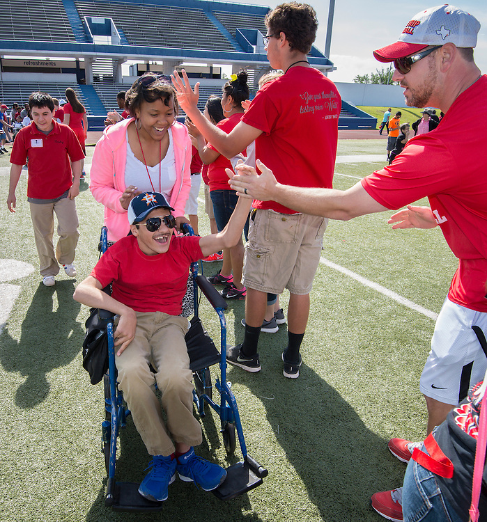 Houston ISD middle schoolers participate in Special Olympics field day at Barnett Stadium, April 30, 2014.