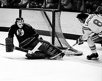 Seals Brian Lavender trying to score against kansas City Scout goalie Bill McKenzie.(1975 photo by Ron Riesterer)