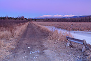 Snowcapped Presidential Range just after sunset from along the Presidential Range Rail Trail (Cohos Trail) at Pondicherry Wildlife Refuge in Jefferson, New Hampshire during the winter months. This trail utilizes the old railroad bed of the Boston & Maine Berlin Branch, which was abandoned and removed in the 1990s. Designated a National Natural Landmark in 1974 by the National Park Service, Pondicherry Wildlife Refuge is located in the towns of Jefferson and Whitefield, New Hampshire.