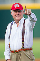 "Howard ""Humpy"" Wheeler salutes the fans at BB&T Ballpark prior to throwing out a ceremonial first pitch prior to the game between the Gwinnett Braves and the Charlotte Knights on August 19, 2014 in Charlotte, North Carolina.  Wheeler is the former President and General Manager of Charlotte Motor Speedway.   (Brian Westerholt/Four Seam Images)"