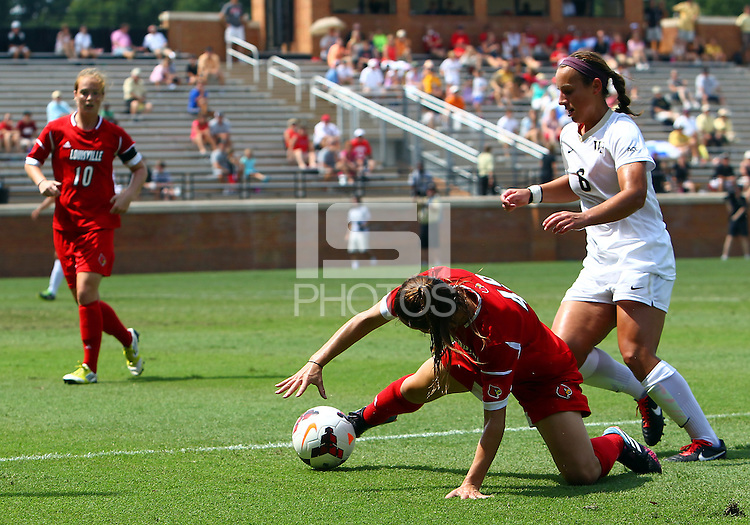 WINSTON-SALEM, NORTH CAROLINA - September 01, 2013:<br /> Megan Berberich (49) of Louisville Universitycontrols the ball in front of Jackie McSally (6) of Wake Forest University during a match at the Wake Forest Invitational tournament at Wake Forest University on September 01. The match was abandoned early in the second half due to severe weather with Wake leading 1-0.