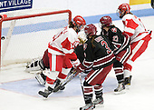 Jenn Wakefield (BU - 9) scores. - The Boston University Terriers defeated the Harvard University Crimson 5-2 on Monday, January 31, 2012, in the opening round of the 2012 Women's Beanpot at Walter Brown Arena in Boston, Massachusetts.
