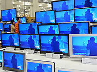 Japanese shoppers in the TV department of wholesale Costco outlet, Tokyo, Japan. Costco has seen a surge in customers, who are able to buy in bulk at wholesale prices, as the economy has taken a down-turn...