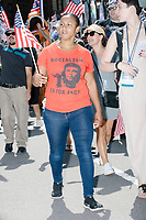 "A woman wears a shirt depicting Cuban revolutionary Che Guevara and the slogan ""Socialism is for fags"" as she marches in the Straight Pride Parade in Boston, Massachusetts, on Sat., August 31, 2019. The parade was organized in reaction to LGBTQ Pride month activities by an organization called Super Happy Fun America."