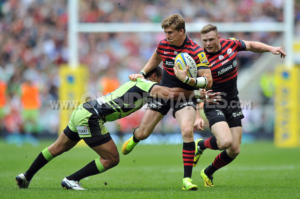David Strettle is tackled in possession. Aviva Premiership Final, between Saracens and Northampton Saints on May 31, 2014 at Twickenham Stadium in London, England. Photo by: Patrick Khachfe / JMP