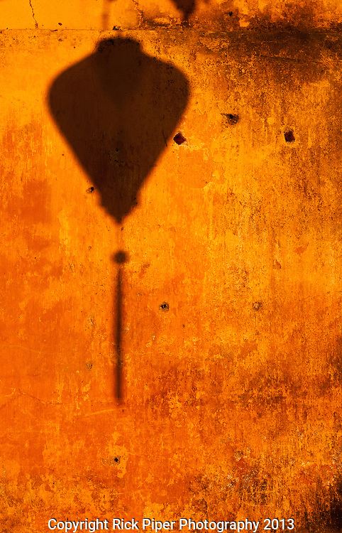 Ochre Wall Lantern Shadow - Shadow of a lantern on a yellow ochre wall, late afternoon, Hoi An, Vietnam.