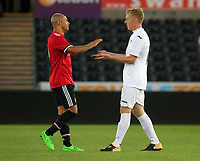 Garry Monk (R) greets a Manchester United Legends player during the Alan Tate Testimonial Match, Swansea City Legends v Manchester United Legends at the Liberty Stadium, Swansea, Wales, UK