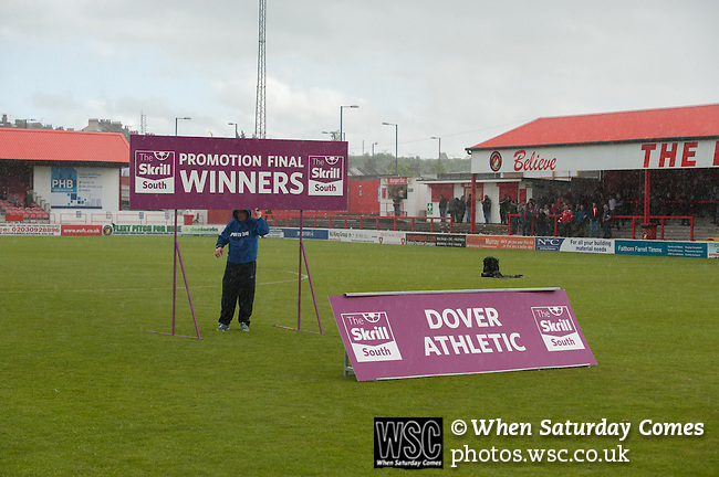 Ebbsfleet 0 Dover Athletic 1, 23/08.2014. Stonebridge Road, Conference South play-off final. The Skrill South play-off final between Ebbsfleet and Dover Athletic from Stonebridge Road. Preparations are made in the pouring rain for the trophy presentation. Dover won the match 1-0 to secure promotion to the Conference Premier. Photo by Simon Gill.
