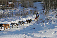 Saturday, February 24th, Knik, Alaska.  Jr. Iditarod musher Caiin Carter  on the trail shortly after leaving the Knik start