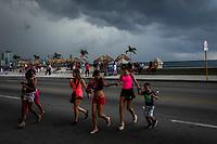 HAVANA, CUBA - JUNE 14: Cuban residents head for shelter as a storm approaches the Malecon in Old Havana, Habana Vieja on June 14, 2015 in Havana, Cuba. <br /> Daniel Berehulak for Panasonic/Lumix