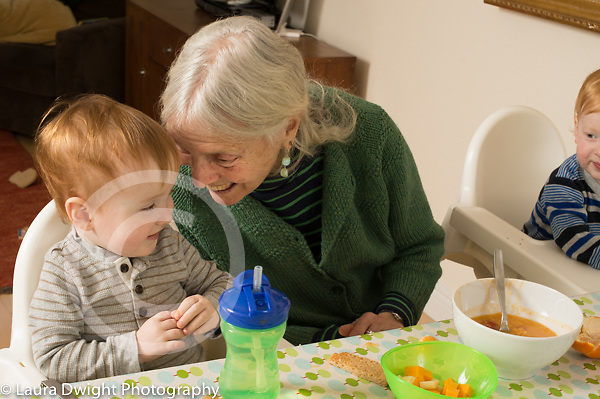 20 month old toddler fraterna twin boys with grandmother, affectionate moment