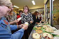 NWA Democrat-Gazette/FLIP PUTTHOFF<br />PIE TIMES TASTE BUDS SQUARED<br />Susan Moore (center) with the Office of Human Concern serves pie Wednesday Feb. 28 2018 to patrons of the Lowell Senior Activity Center during a pie-baking contest at the center. Four judges scored 16 home-baked pies submitted by  patrons on a variety of criteria. Slices of pie were sold after the contest to raise money for the center, said Stefanie Jackson with the Office of Human Concern. Diana Osborn (cq) of Springdale won the contest with a cherry cheese pie she baked.