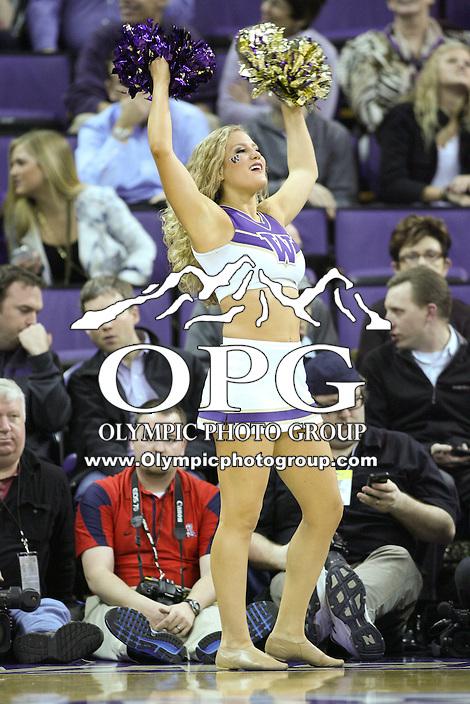 Jan 31, 2013:  Washington cheerleader Hannah Tripp pumped up the crowed during a timeout against Arizona.  Arizona defeated Washington 57-53 at Alaska Airlines Arena Seattle, Washington...