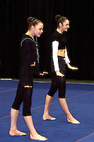 (L-R) Galina Shyrkina and Anna Bessonova of Ukraine begin duet gala exhibition at San Francisco Invitational on February 11, 2006. Bessonova won All-Around competition. (Photo by Tom Theobald)