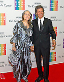Chick Corea and his wife, Gayle, arrive for the formal Artist's Dinner honoring the recipients of the 2013 Kennedy Center Honors hosted by United States Secretary of State John F. Kerry at the U.S. Department of State in Washington, D.C. on Saturday, December 7, 2013. The 2013 honorees are: opera singer Martina Arroyo; pianist,  keyboardist, bandleader and composer Herbie Hancock; pianist, singer and songwriter Billy Joel; actress Shirley MacLaine; and musician and songwriter Carlos Santana.<br /> Credit: Ron Sachs / CNP
