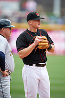 Nashville Sounds third baseman Matt Chapman (7) talks with manager Arnie Beyeler (22) while warming up in between innings during a game against the New Orleans Baby Cakes on May 1, 2017 at First Tennessee Park in Nashville, Tennessee.  Nashville defeated New Orleans 6-4.  (Mike Janes/Four Seam Images)
